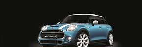 The new MINI 5-door Hatch rolls off the lines at Oxford.